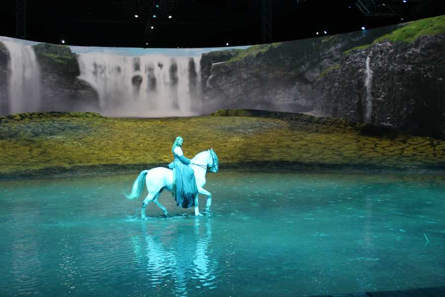 The horses, riders and artists enjoy splashing through the lake