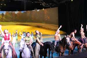 The performers wave to the audience at the end of the show