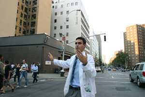 Medical student Michael Khalili directs traffic outside of Mount Sinai Medical Center in upper Manhattan during a massive power outage that stretched from New York to Detroit and into Canada, Thursday, Aug. 14, 2003.