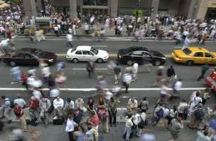 Crowds of people pour onto 42nd Street near Grand Central Station in New York City after a power outage forced them from surrounding buildings Thursday, Aug. 14, 2003. The outage that hit cities in northeastern United States and Canada, also disrupted cell phone service in New York, the subway system and trains going in and out.