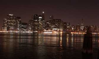 The Manhattan skyline, viewed from across the East River in Brooklyn, is ablaze with lights after power was fully restored to the city Friday, Aug. 15, 2003.