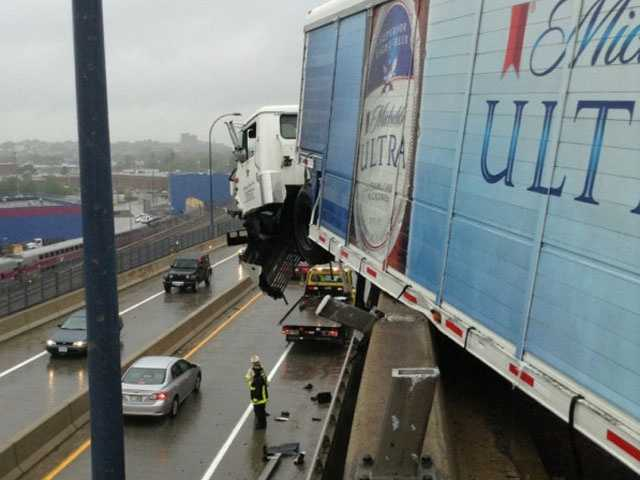 The Boston Fire Department said the truck driver and his passenger are both out of the vehicle.