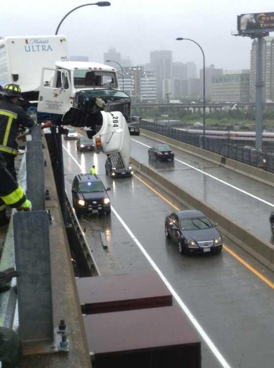 Cars travel below the crash.