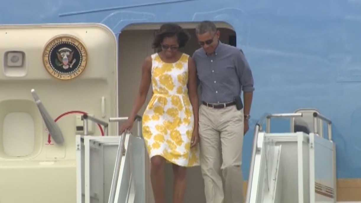 President Barack Obama and the First Lady arrive at Otis Air Force Base in Bourne on Aug. 10, 2013.