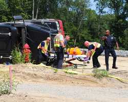 A 61-year-old construction worker from Plymouth was injured Tuesday afternoon when the 12-wheel dump truck he was operating tipped over.