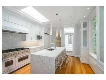 Agorgeous sky-lit gourmet kitchen.