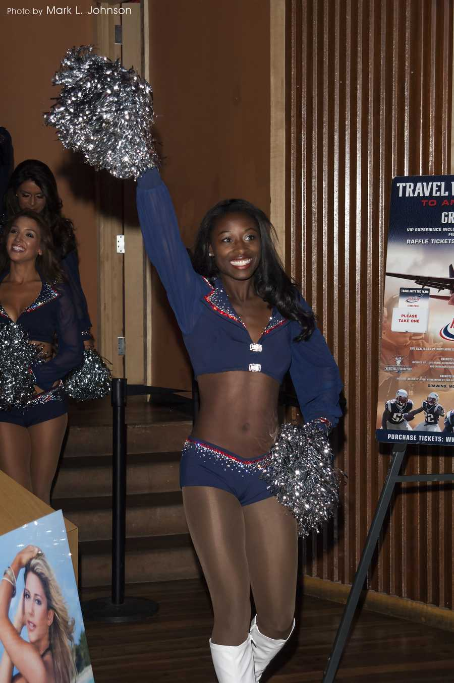 The New England Patriots cheerleadersshow off their new uniforms that were designed by Waltham's own Sondra Celli.