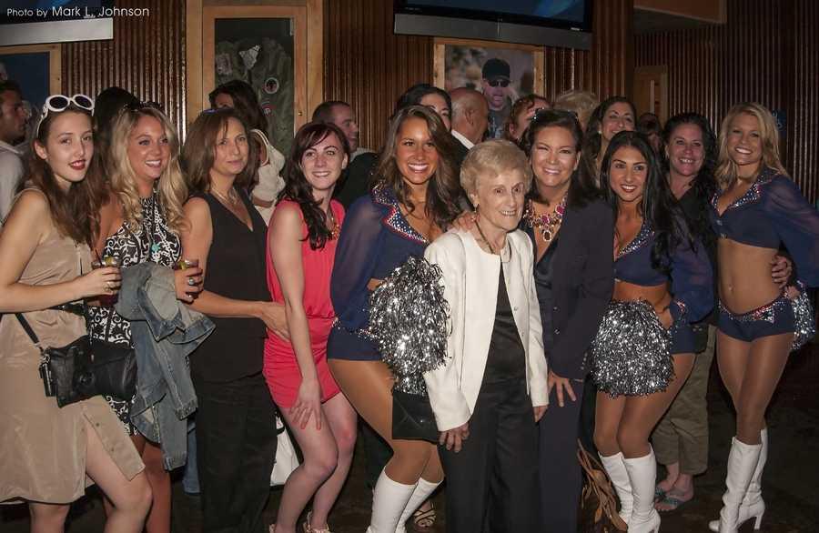 Members of Sondra's staff pose with the cheerleaders.