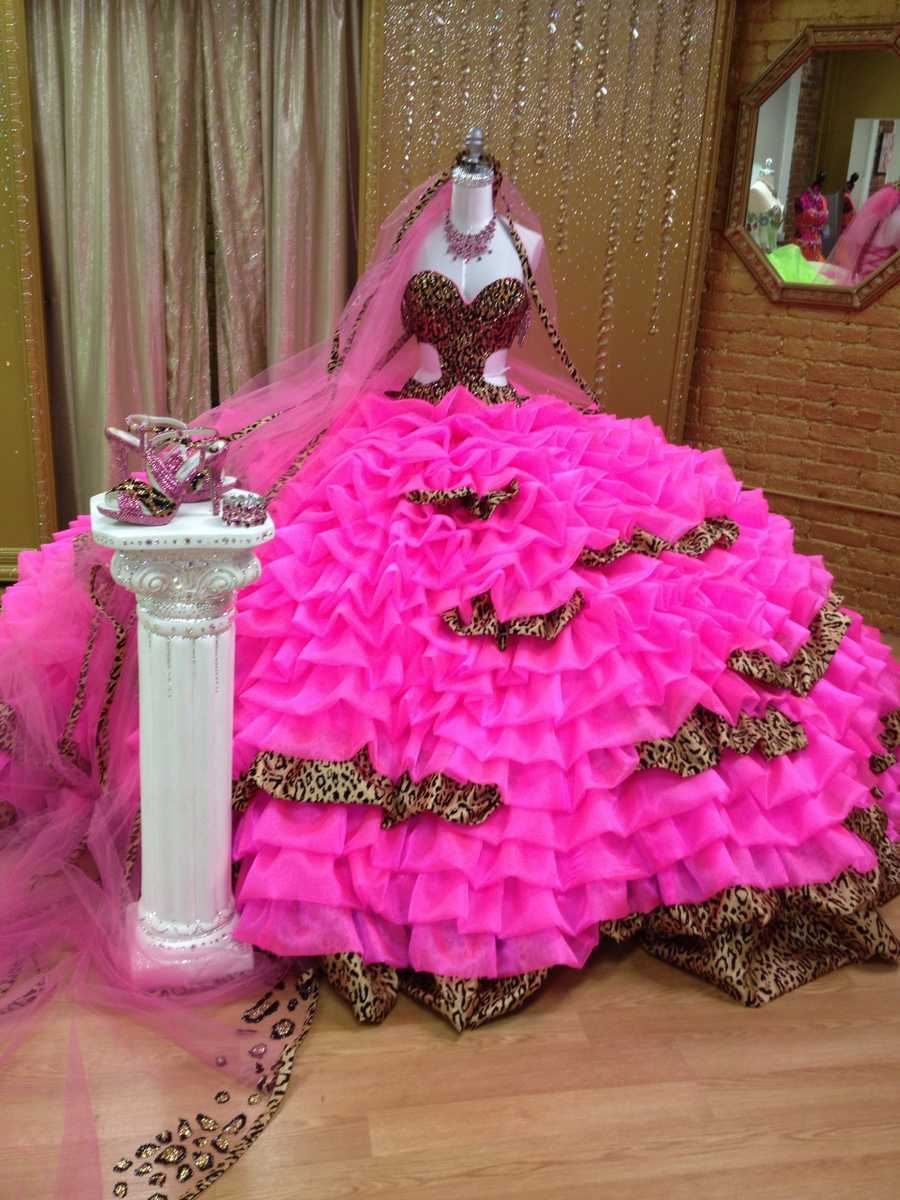"""When asked to custom design a wedding dress for """"Hellie"""" Mellie Stanley, Sondra Celli, """"America's No.1 Gypsy Designer"""" combined a wild leopard print with a """"screaming"""" hot pink satin organza."""