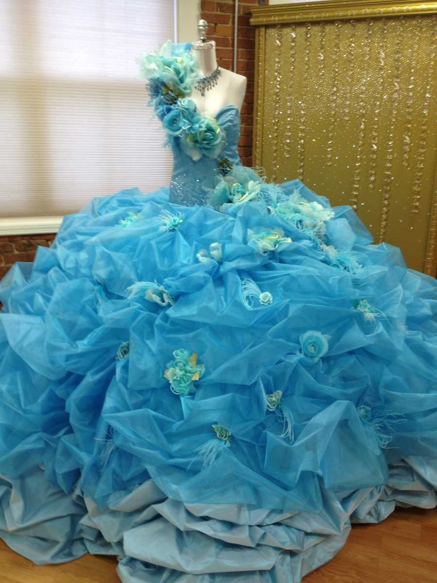 Sondra designed this wedding dress for a bride whose favorite color was blue and her dream was to wear a blue fantasy-style dress.