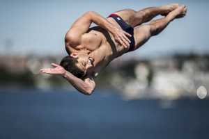 USA diver Steven LoBue jumps from the 90 foot platform during the first round of the fifth stop of the Red Bull Cliff Diving World Series, Boston, USA on August 24th 2013.