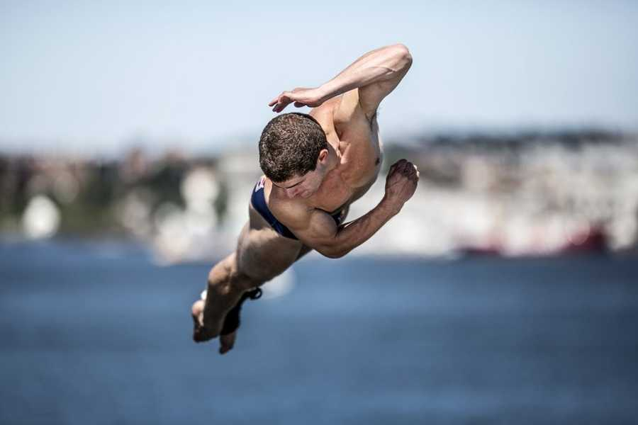 David Colturi of the USA dives from the 90 foot platform during the first round of the fifth stop of the Red Bull Cliff Diving World Series, Boston, USA on August 24th 2013.