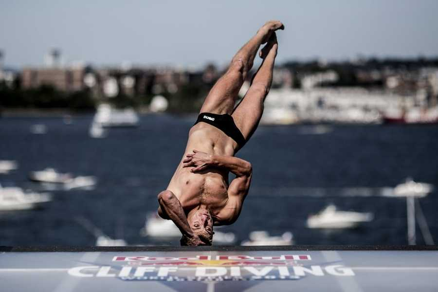 Artem Silchenko of Russia dives during the fifth stop of the Red Bull Cliff Diving World Series, Boston, USA on August 25th 2013.