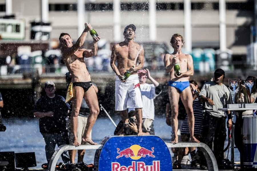 Artem Silchenko (L) of Russia, Orlando Duque (C) of Colombia and Gary Hunt (R) of the UK celebrate on the podium during the fifth stop of the Red Bull Cliff Diving World Series, Boston, USA on August 25th 2013.