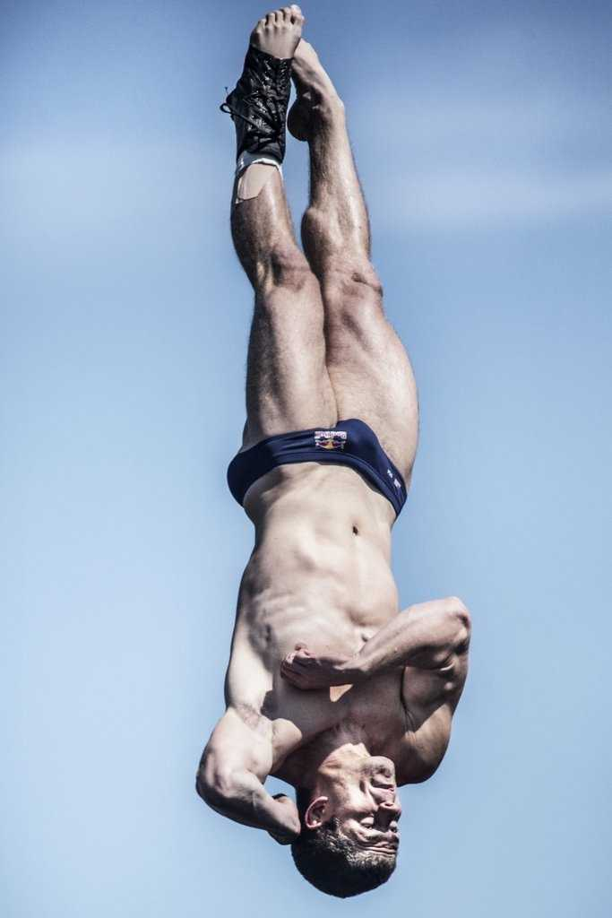 David Colturi of the USA dives from the 90 foot platform during the fifth stop of the Red Bull Cliff Diving World Series, Boston, USA on August 25th 2013.