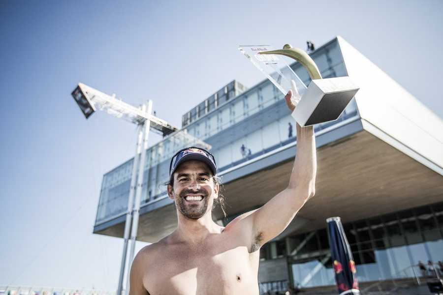 Orlando Duque of Colombia celebrates after winning the fifth stop of the Red Bull Cliff Diving World Series, Boston, USA on August 25th 2013.