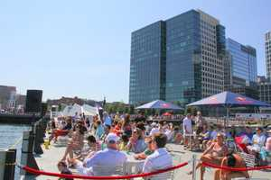 Thousands gathered around the Institute of Contemporary Art building in the Boston Seaport district to watch the high diving competition.