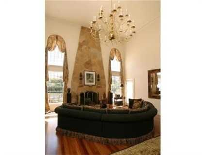The family room has a gorgeous fireplace and chandelier.