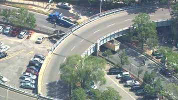 The top of a box truck was ripped open after trying to pass under a low-height bridge along Storrow Drive Monday.