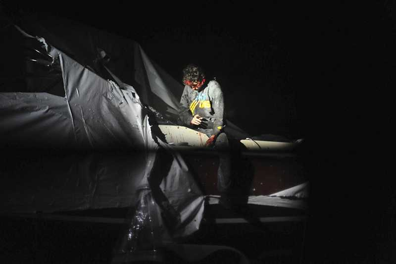 Boston Marathon bombing suspect Dzhokhar Tsarnaev leans over in a boat at the time of his capture by law enforcement authorities in Watertown, Mass.Photos of the Boston Marathon bombing suspect's surrender have been posted on the Boston Magazine website.The additional images, made public Tuesday, Aug. 27, were among those released to the magazine last month by a state police photographer.