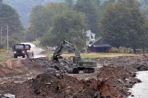 One of the hardest hit areas was the state of Vermont, where thousands had their lives forever changed by Irene. This picture shows the Maine National Guard working to Route 107, washed away by flooding from Irene.