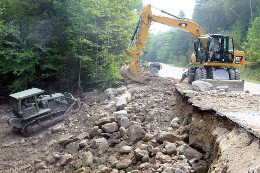 Vermont National Guard members work to fix state roads damaged by flooding after Hurricane Irene.