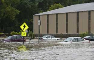 Cars in the parking lot at the bottom of Canal St. are submerged nearly to their windows by the flooding Whetstone Brook in Brattleboro, Vt. on Sunday, Aug. 28, 2011.