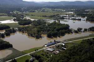 In this Aug. 30, 2011, file photo, farmer's fields are flooded from Tropical Storm Irene in this aerial view on Tuesday, Aug. 30, 2011 in Rutland, Vt.