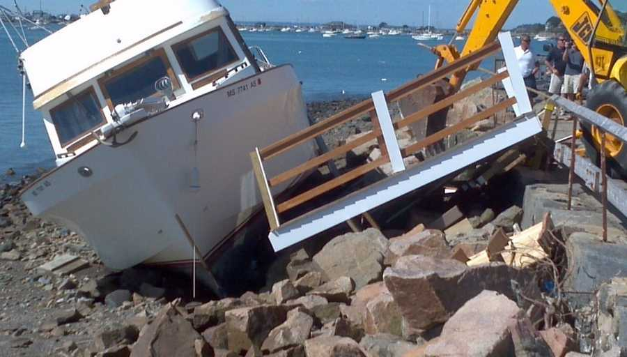 Boat pushed ashore in Hull, Mass., hits private dock