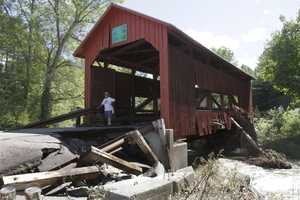 A damaged historic covered bridge spans Cox Brook in Northfield, Vt., Monday, Aug. 29, 2011.