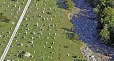 In this Aug. 30, 2011 photo in Rochester, Vt., the damaged Woodlawn Cemetery is seen