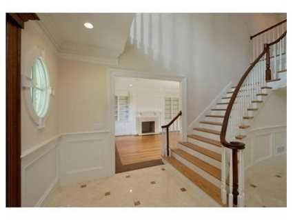 Step into this grand foyer and experience comfortable living and spectacular entertaining space.