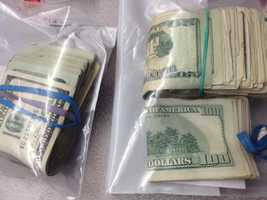 Police seized several items in the bust, including cash, cocaine and heroin.