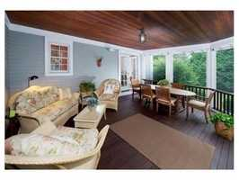 The home is situated on a half acre lot set back from the road.
