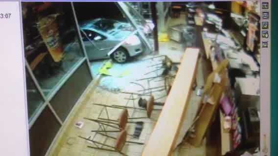 Surveillance Video: Car crashes into Dover Dunkin' Donuts