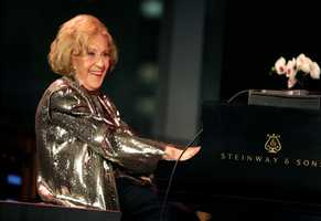 """Marian McPartland was a renowned jazz pianist and host of the National Public Radio show """"Piano Jazz."""" Over a career that spanned more than six decades, McPartland became a fixture in the jazz world as a talented musician and well-loved radio personality. (20 March 1918 – 20 August 2013)"""