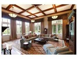 A sunken great room with a coffered ceiling.