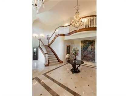 A two-story marble entry foyer.