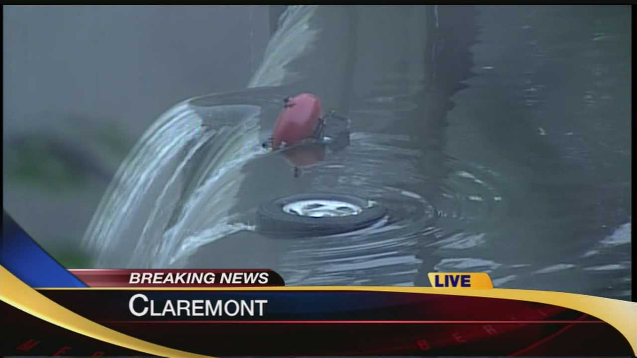 A pickup truck was submerged in the Sugar River in Claremont early Friday morning.