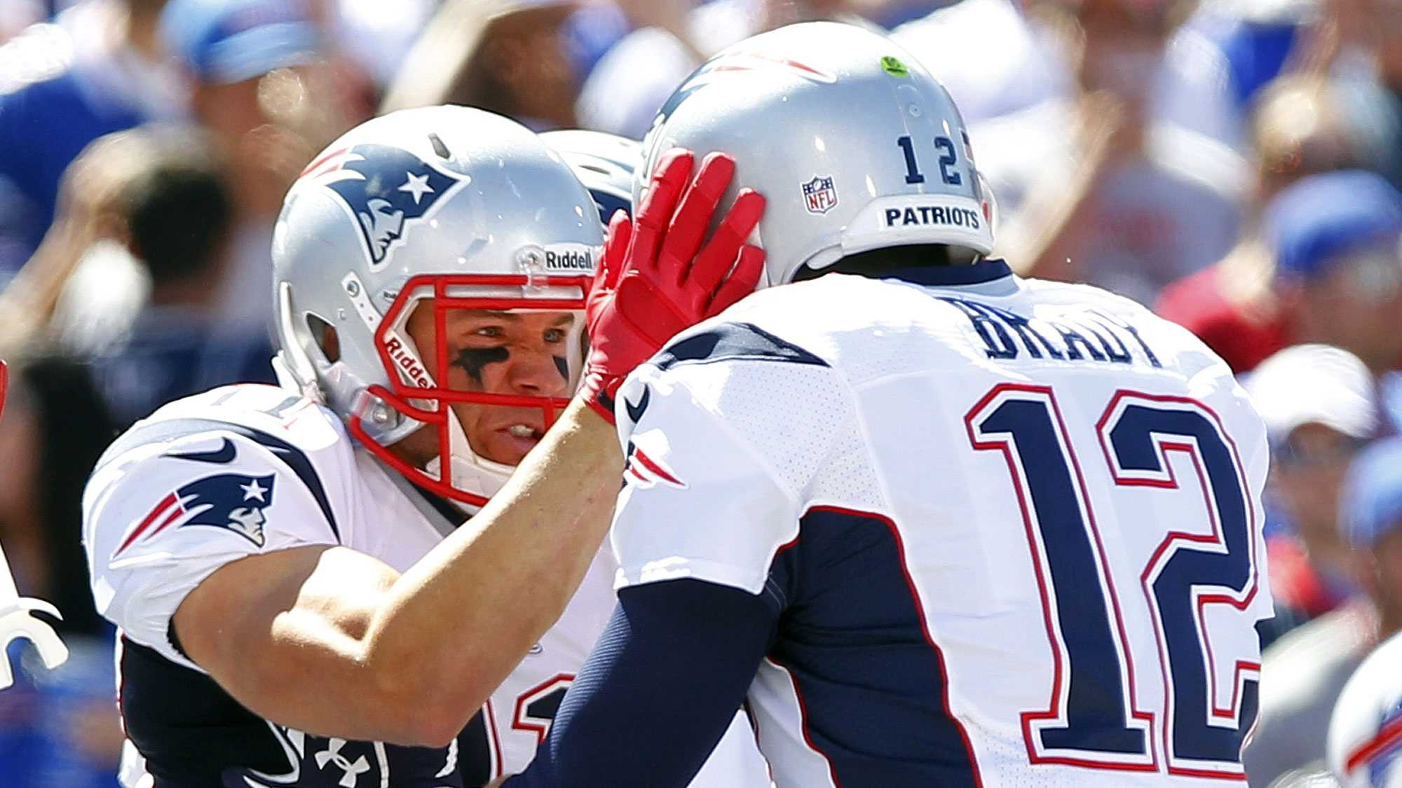 New England Patriots' Julian Edelman, left, celebrates with teammate Tom Brady, right, after catching a touchdown pass during the first half of an NFL football game against the Buffalo Bills, Sunday, Sept. 8, 2013, in Orchard Park.