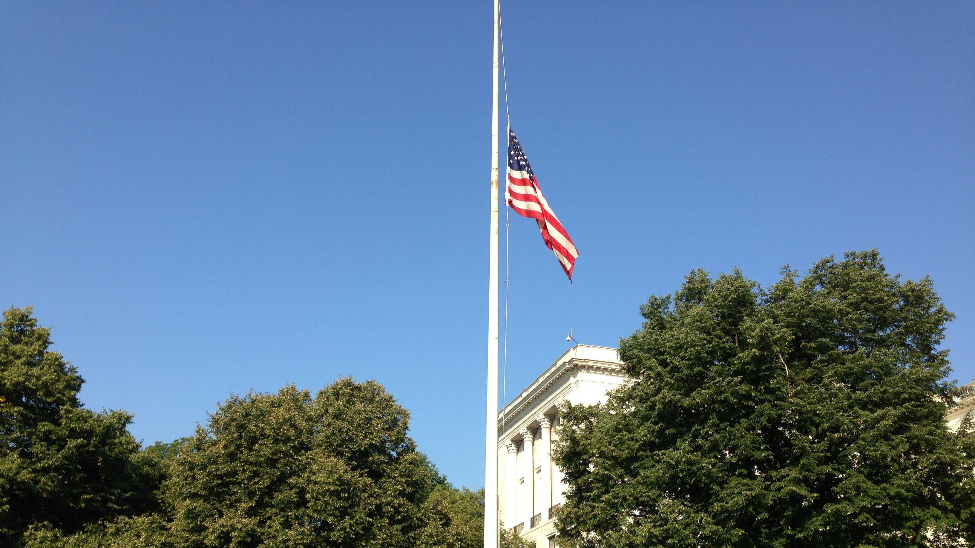 The flag is lowered at the Statehouse.