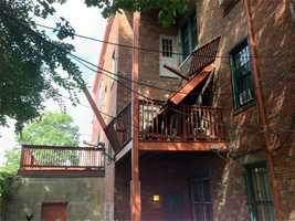 Seven young adults were hospitalized Friday after a third-floor porch collapsed under them.