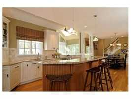 The fabulous chef's kitchen opens to a dramatic family room.