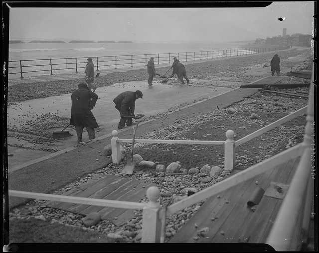 Teams start the arduous process of cleaning up and repairing the Winthrop seawall.