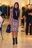Amanda Bailey walks the fashion runway modeling her outfit.