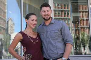 The couple posed for this photo outside after the fashion show.