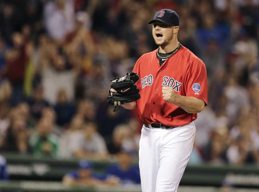 Boston Red Sox starting pitcher Jon Lester pumps his fist and yells after getting Toronto Blue Jays' Jose Reyes to strike out ending the top half of the seventh inning of a baseball game at Fenway Park, Friday, Sept. 20, 2013.