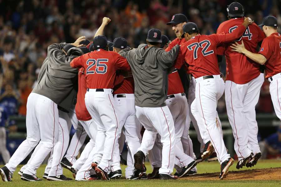 The Boston Red Sox celebrate after clinching the AL East with a 6-3 win over the Toronto Blue Jays in a baseball game at Fenway Park, Friday, Sept. 20, 2013, in Boston.