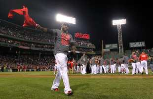 Boston Red Sox designated hitter David Ortiz celebrates after the Red Sox clinched the AL East title with a 6-3 win over the Toronto Blue Jays in a baseball game at Fenway Park, Friday, Sept. 20, 2013, in Boston.