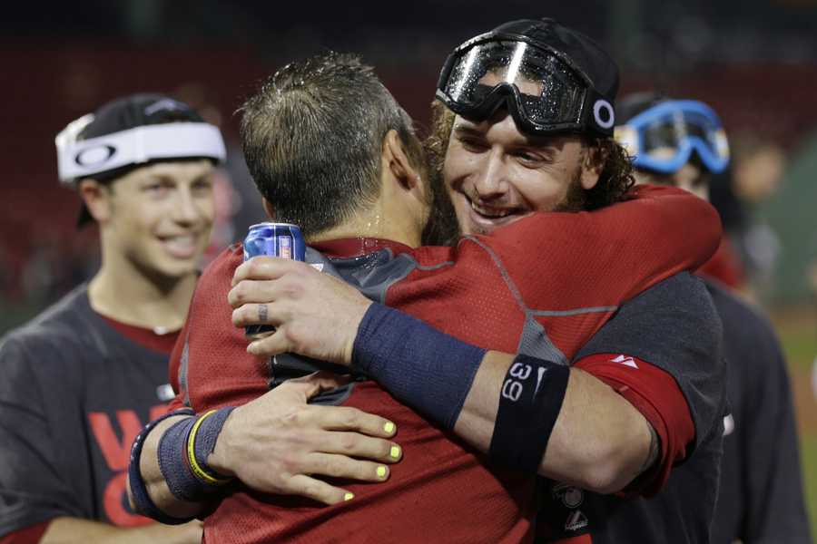 Boston Red Sox catcher Jarrod Saltalamacchia, right, celebrates with teammates after the Red Sox clinched the AL East title with a 6-3 win over the Toronto Blue Jays in a baseball game at Fenway Park, Friday, Sept. 20, 2013, in Boston.